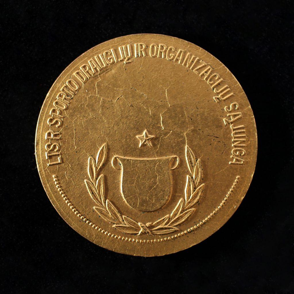 Šis paveikslėlis neturi alt atributo; jo failo pavadinimas yra Jono-Ževeliausko-1962-m.-aukso-medalis-reversas-1024x1024.jpg